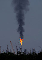 Apr. 28, 2013; Baytown, TX, USA: View of fire from an oil refinery factory near the Spring Nationals at Royal Purple Raceway. Mandatory Credit: Mark J. Rebilas-