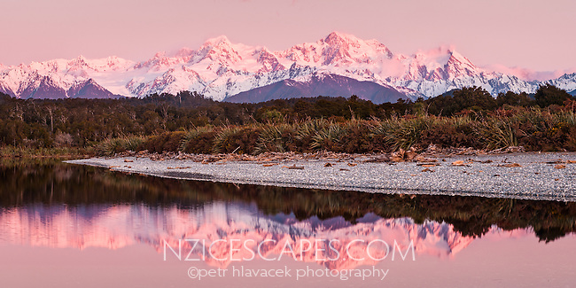 Twilight at Gillespies Lagoon with reflections of highest NZ mountains, Aoraki Mt. Cook (3724m right) and Mt. Tasman (3497m left), Fox Glacier just visible on left, Westland Tai Poutini National Park, UNESCO World Heritage Area, West Coast, New Zealand, NZ
