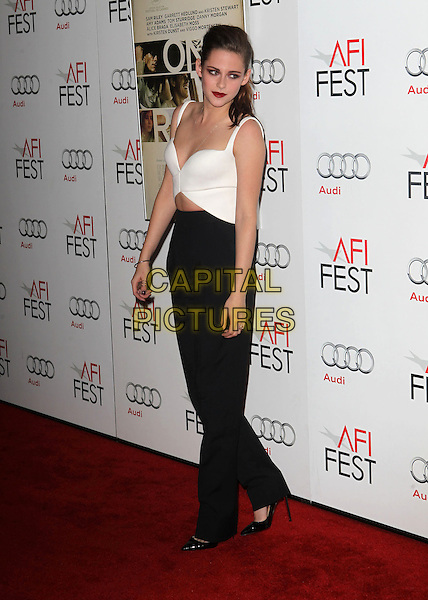 Kristen Stewart.AFI FEST 2012 'On The Road' gala screening, Grauman's Chinese Theatre, Hollywood, California, USA..3rd November 2012.full length white top cut out away black trousers .CAP/ADM/KB.©Kevan Brooks/AdMedia/Capital Pictures.