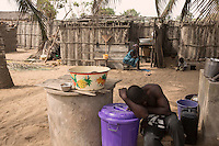 Ghana - Fuveme - David Buabasah, 32, is a fisherman from Fuvemeh. Coastal erosion has recently destroyed part of his house, prompting his wife and 8 kids to find shelter in nearby villages. « When I was a kid, our house used to be at the center of the village and I couldn't see the sea from there. Now, due to coastal erosion, we are at the forefront » he explains.