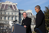 President Francois Hollande of France'left, pauses while speaking during an arrival ceremony with United States President Barack Obama on the South Lawn of the White House in Washington, D.C., U.S., on Tuesday, Feb. 11, 2014. <br /> Credit: Andrew Harrer / Pool via CNP