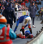 16.02.2020 Rangers v Livingston: Andy Halliday falls over the LED board at full pelt and lands on an upturned metal chair