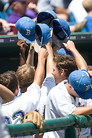 UCLA bench celebrates scoring in Game 13 of the NCAA Division One Men's College World Series on June 26th, 2010 at Johnny Rosenblatt Stadium in Omaha, Nebraska.  (Photo by Andrew Woolley / Four Seam Images)