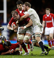 Photo: Richard Lane/Richard Lane Photography. Wales v England. RBS 6 Nations Championship. 16/03/2013. Wales' Alun Wyn Jones is tackled by England's Chris Robshaw.