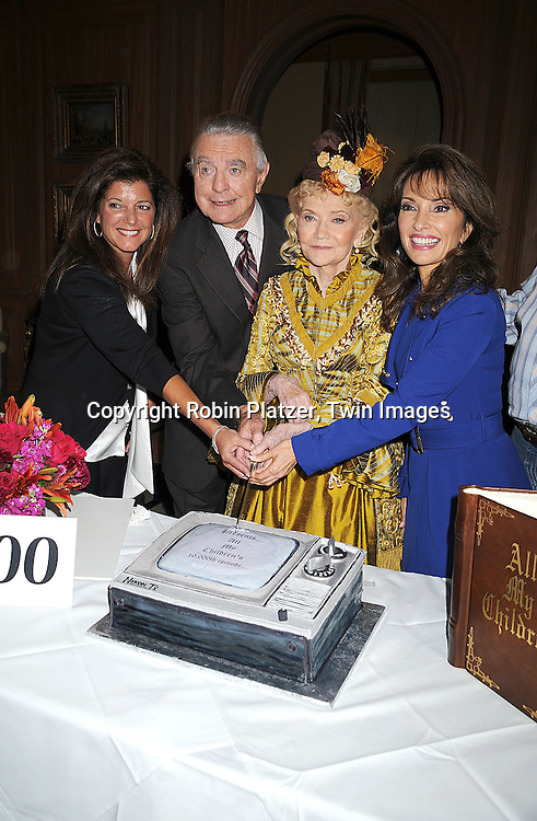 "Producer Julie Hannon Caruthers, Ray MacDonnell, Agnes Nixon and Susan Lucci cutting the cake..at he taping of the 10,000th episode of ""All My Children"" on October 16, 2008 at their studio. ....Robni Platzer, Twin Images"