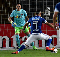 BOGOTA - COLOMBIA – 17 - 04 - 2018: Ayron del Valle (Der.) jugador de Millonarios (COL), disputa el balon con Carlos Salazar (Izq.) guardameta de Deportivo Lara (VEN), durante partido entre Millonarios (COL) y Deportivo Lara (VEN), de la fase de grupos, grupo G, fecha 3 de la Copa Conmebol Libertadores 2018, en el estadio Nemesio Camacho El Campin, de la ciudad de Bogota. / Ayron del Valle (R) player of Millonarios (COL), figths for the ball with Carlos Salazar (L) goalkeeper of Deportivo Lara (VEN), during a match between Millonarios (COL) and Deportivo Lara (VEN), of the group stage, group G, 3rd date for the Conmebol Copa Libertadores 2018 in the Nemesio Camacho El Campin stadium in Bogota city. VizzorImage / Luis Ramirez / Staff.