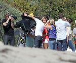 .May 21st 2012   Exclusive ..Demi Lovato riding a yellow bicycle wearing red shirt & white shorts on the beach in Malibu California filming a music video.  Demi was laughing, dancing &  carrying a surfboard in one scene & wearing a lime green tight dress in another. The crew tried to block the photographer with huge white screens but Demi still smiled & seemed extremely happy to be on set filming. ...AbilityFilms@yahoo.com.805-427-3519.www.AbilityFilms.com.