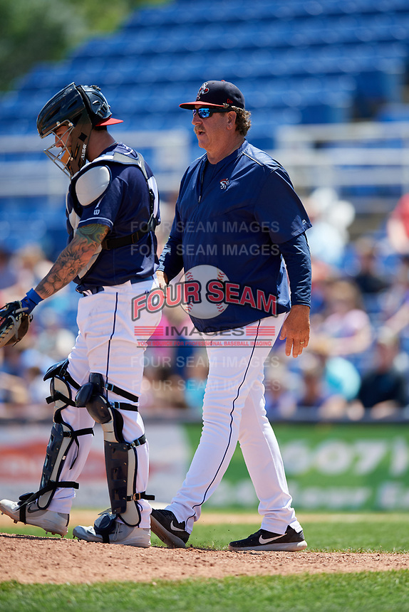 Binghamton Rumble Ponies pitching coach Frank Viola (48) walks to the mound with catcher Tomas Nido (7) during a game against the Altoona Curve on June 14, 2018 at NYSEG Stadium in Binghamton, New York.  Altoona defeated Binghamton 9-2.  (Mike Janes/Four Seam Images)