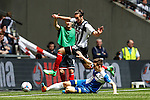 Ollie Palmer of Grimsby Town evdes the challenge from Tom Lockyer of Bristol Rovers during the 2015 Vanarama Conference Promotion Final match between Grimsby Town and Bristol Rovers at Wembley Stadium, London<br /> Picture by David Horn/eXtreme aperture photography +44 7545 970036<br /> 17/05/2015