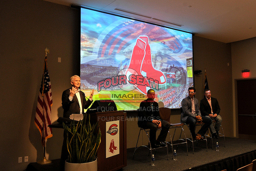 Greenville Drive Owner/Team President Craig Brown speaks at the Greenville Drive's annual Hot Stove Event on Tuesday, January 26, 2016, in the ONE Building in Downtown Greenville, South Carolina. On the stage with him are:  Drive General Manager Eric Jarinko; Boston Red Sox General Manager Mike Hazen; and Greenville Drive Manager Darren Fenster. (Tom Priddy/Four Seam Images)