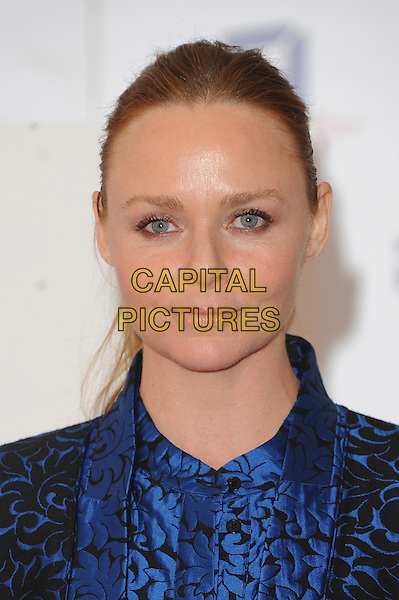 Stella McCartney.The UK Creative Industries Reception supported by The Founders Forum, at the Royal Academy of Arts, London, as part of HM Government's GREAT campaign alongside the very best of the UK Creative Industries from the fields of music, film, art and entertainment..30th July 2012 .headshot portrait black blue print .CAP/BEL.©Tom Belcher/Capital Pictures.