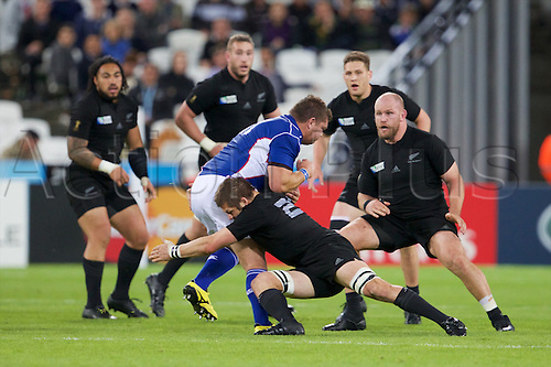 24.09.2015. Olympic Stadium, London, England. Rugby World Cup. New Zealand versus Namibia. New Zealand All Black flanker Richie McCaw makes a tackle.
