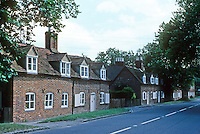 Nuneham Courtenay: On the A-423 near Oxford; shown, three of 19 pairs of cottages + forge, curate's cottage and inn, by Lord Harcourt, early 1760's. Photo '87.