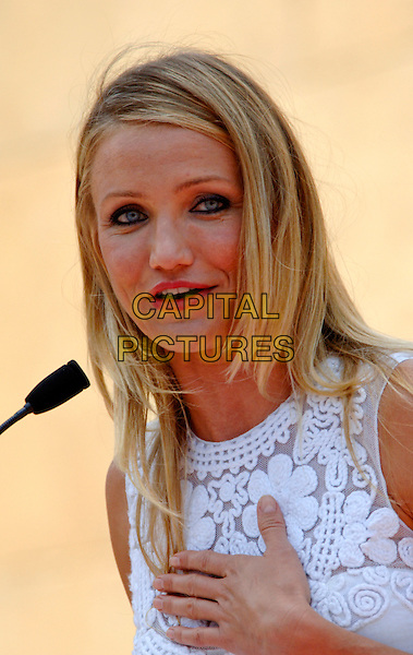 CAMERON DIAZ .Cameron Diaz Honored With Star on the Hollywood Walk of Fame held in front of Grauman's Egyptian Theatre, Hollywood, CA, USA. .June 22nd, 2009 .headshot portrait white lace sleeveless hand.CAP/VR.©Victor Rosenthal/Capital Pictures