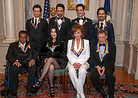The recipients of the 41st Annual Kennedy Center Honors pose for a group photo following a dinner hosted by United States Deputy Secretary of State John J. Sullivan in their honor at the US Department of State in Washington, D.C. on Saturday, December 1, 2018.  From left to right back row: Thomas Kail, Lin-Manuel Miranda, Andy Blankenbuehler, and Alex Lacamoire.  Front row, left to right: Wayne Shorter, Cher, Reba McEntire, and Philip Glass The 2018 honorees are: singer and actress Cher; composer and pianist Philip Glass; Country music entertainer Reba McEntire; and jazz saxophonist and composer Wayne Shorter. This year, the co-creators of Hamilton,? writer and actor Lin-Manuel Miranda; director Thomas Kail; choreographer Andy Blankenbuehler; and music director Alex Lacamoire will receive a unique Kennedy Center Honors as trailblazing creators of a transformative work that defies category.<br /> CAP/MPI/RS<br /> &copy;RS/MPI/Capital Pictures