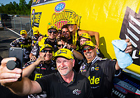 May 6, 2018; Commerce, GA, USA; NHRA top fuel driver Leah Pritchett (back center) celebrates with crew after winning the Southern Nationals at Atlanta Dragway. Mandatory Credit: Mark J. Rebilas-USA TODAY Sports