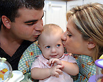 Giana Lattuga, age 9 months, with her parents Craig and Jenniffer Lattuga, at their home in Shirley on Thursday September 14, 2006.  (Newsday Photo / Jim Peppler).