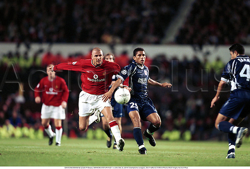 DAVID BECKHAM & Sylain N'Diaye, MANCHESTER UNITED 1 v Lille OSC 0, UEFA Champions League, Old Trafford 010918 Photo:Neil Tingle/Action Plus...2001.Soccer.Premier league.football.english premiership club clubs.association