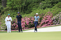 Adam Scott (AUS) and Thorbjorn Olesen (DEN) on the 13th green during the final round at the The Masters , Augusta National, Augusta, Georgia, USA. 14/04/2019.<br /> Picture Fran Caffrey / Golffile.ie<br /> <br /> All photo usage must carry mandatory copyright credit (© Golffile | Fran Caffrey)