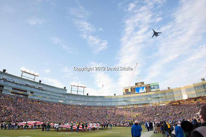 A general view of Lambeau Field from field level during the National Anthem of the Green Bay Packers NFL divisional playoff football game against the New York Giants as a B-1 Bomber does a fly over on January 15, 2012 in Green Bay, Wisconsin. The Giants won 37-20. (AP Photo/David Stluka)