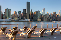 View of the Manhattan skyline over the East River including the Trump World Tower and Citigroup building from Gantry Plaza State Park in Long Island City, Queens, New York