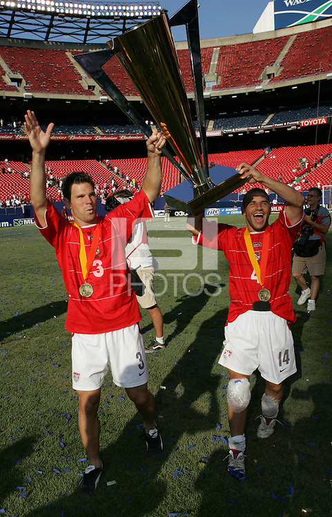July 24, 2005: East Rutherford, NJ, USA:  USMNT teammates Chris Armas (14) and Greg Vanney (3) raise the trophy after winning the CONCACAF Gold Cup at Giants Stadium by defeating Panama on penalty kicks.