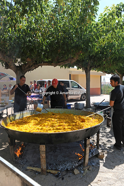 Fideua, a traditional Valencian seafood macaroni dish not unlike paella, for 400 is prepared for lunch for the entire town with the help of outsiders during the town's municipal fiestas in Costur, Spain on August 19, 2009.