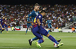 Suarez in action during Supercopa de España game 1 between FC Barcelona against Real Madrid at Camp Nou