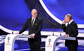1st December 2017, State Kremlin Palace, Moscow, Russia;  FIFA president Gianni Infantino (L) speaks beside President of Russia Vladimir Putin during the FIFA 2018 World Cup draw at the State Kremlin Palace in Moscow, Russia