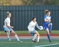 Boston Breakers midfielder Heather O'Reilly (9) passes the ball as Chicago Red Stars defender Michelle Wenino (23) and Chicago Red Stars defender Lydia Vandenbergh (13) close. In a National Women's Soccer League Elite (NWSL) match, the Boston Breakers (blue) defeated Chicago Red Stars (white), 4-1, at Dilboy Stadium on May 4, 2013.