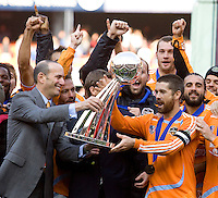 Houston Dynamo defender/captain (24) Wade Barrett is presented the Alan I. Rothenberg Trophy by MLS commissioner Don Garber. The Houston Dynamo defeated the New England Revolution 2-1 in the finals of the MLS Cup at RFK Memorial Stadium in Washington, D. C., on November 18, 2007.