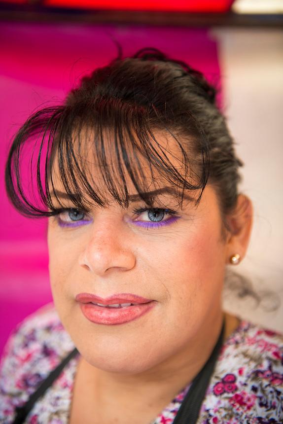 Wendy a trandgender wrestler (Luchadora) whos wrestling name is Gaviota (seagul) at her street hair saloon; her day job. Garibaldi, Mexico City