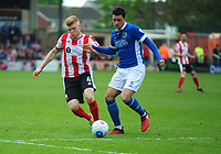Lincoln City's Elliott Whitehouse vies for possession with Macclesfield Town's Oliver Norburn<br /> <br /> Photographer Andrew Vaughan/CameraSport<br /> <br /> Vanarama National League - Lincoln City v Macclesfield Town - Saturday 22nd April 2017 - Sincil Bank - Lincoln<br /> <br /> World Copyright &copy; 2017 CameraSport. All rights reserved. 43 Linden Ave. Countesthorpe. Leicester. England. LE8 5PG - Tel: +44 (0) 116 277 4147 - admin@camerasport.com - www.camerasport.com
