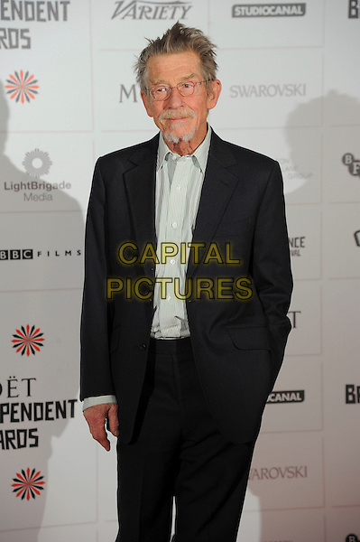 John Hurt.Independent Film Awards, Old Billingsgate Market, London, England..December 9th, 2012.half length black suit white shirt glasses goatee facial hair hand in pocket .CAP/CAS.©Bob Cass/Capital Pictures.