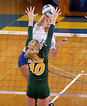 BROOKINGS, SD - SEPTEMBER 30:  Emily Veldman #12 from South Dakota State tries to get a kill past Hadley Steffen #10 from North Dakota State in the second game of their match Tuesday night at Frost Arena in Brookings. (Photo/Dave Eggen/Inertia)