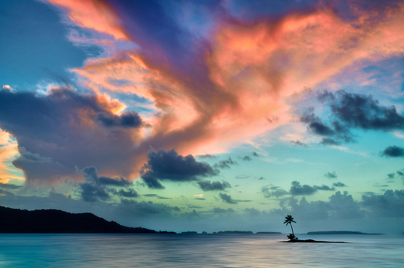 Small island and sunset in Bora Bora. French Polynesia.