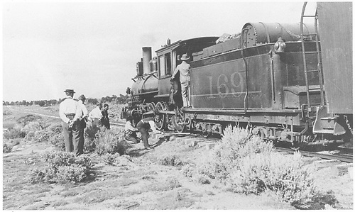 3/4 rear fireman's-side view of D&amp;RG #169 derailed somewhere on the Santa Fe Branch.<br /> D&amp;RG  Santa Fe Branch, NM