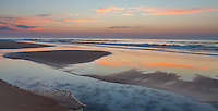 Ocracoke Island, North Carolina: Sunrise clouds reflected in a tide current on a quiet beach - Cape Hatteras National Seashore