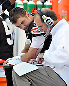 Landover, MD - October 19, 2008 -- Cleveland Browns quarterback Derek Anderson (3), left, goes over photos and strategy with Assistant Head Coach and Quarterbacks Coach Rip Scherer during the second quarter against the Washington Redskins at FedEx Field in Landover, Maryland on Sunday, October 19, 2008.  The Redskins won the game 14 - 11..Credit: Ron Sachs / CNP
