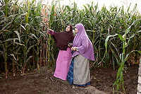 Maryam, a young Sister, stands in front of a field in a rural village with a woman from the area. Egypt, June 2012.