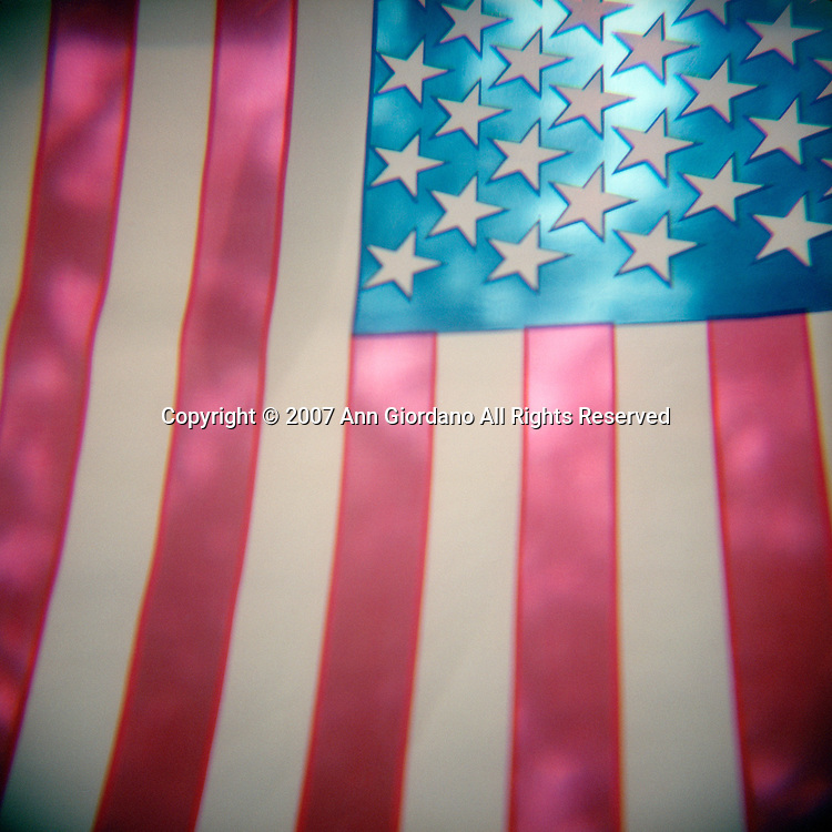 Cropped view of backlit American flag