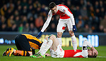 Per Mertesacker of Arsenal holds his head following a clash of heads with Nick Powell of Hull City - English FA Cup - Hull City vs Arsenal - The KC Stadium - Hull - England - 8th March 2016 - Picture Simon Bellis/Sportimage