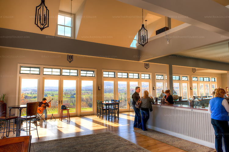 The tasting room at Delaplane Cellars is very spacious, with large bar and tables, all of which enjoy a fabulous view of the valley below.  Live music is offered many weekends in season.  (HDR image)