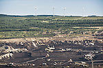 A coal mine in Northwesten Czech Republic and in the background, 4 wind turbines.
