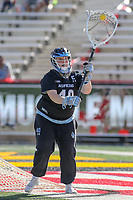 College Park, MD - April 27, 2019: John Hopkins Bluejays goalie Haley Crosson (40) passes the ball during the game between John Hopkins and Maryland at  Capital One Field at Maryland Stadium in College Park, MD.  (Photo by Elliott Brown/Media Images International)