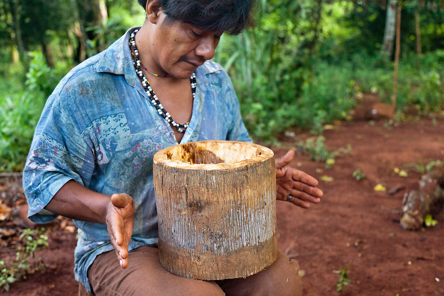 Angel Morinigo, an Mbya Guarani craftsman and musician from Andresito village near San Ignacio, Misiones, Argentina, hand-building a Guarani drum (anguapu) from a palm trunk.