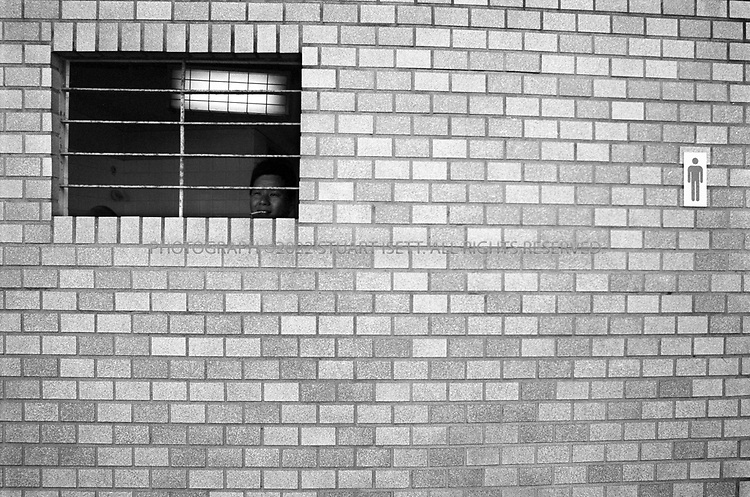 April, 2001--Kyoto, Japan..At the entrance to the Kyoto National Museum visitors pass the men's room...All photographs ©2003 Stuart Isett.All rights reserved.This image may not be reproduced without expressed written permission from Stuart Isett.