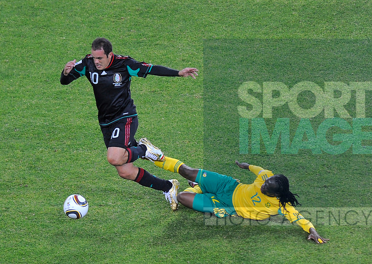 Reneilwe Letsholonyane of South Africa tackles Paul Aguilar of Mexico