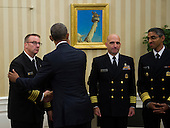 United States President Barack Obama shakes hands with Captain Calvin Edwards, Officer-in-Charge, Team 1, after meeting with members of the Public Health Service Commissioned Corps (PHS CC) after signing a citation awarding the Presidential Unit Citation to PHS CC members who participated in the Ebola containment efforts in West Africa, in the Oval Office at The White House in Washington, D.C., U.S., on Thursday, Sept. 24, 2015. <br /> Credit: Rod Lamkey Jr. / Pool via CNP