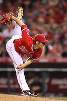 C.J. Wilson #33 of the Los Angeles Angels pitches against the Oakland Athletics at Angel Stadium on April 19, 2012 in Anaheim,California. Oakland defeated Los Angeles 4-2.(Larry Goren/Four Seam Images)